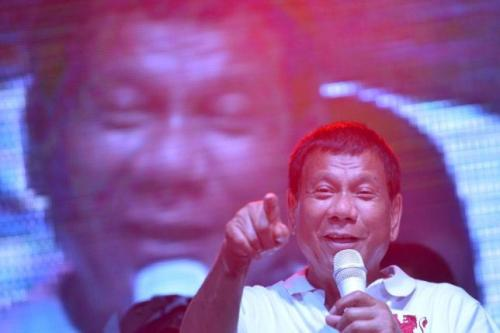 Philippine presidential candidate and Davao city mayor Rodrigo 'Digong' Duterte gestures while delivering a speech during a May Day campaign rally in Manila, Philippines